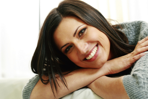 Woman smiling about the restorative procedure she received from her dentist  at Tower Dental